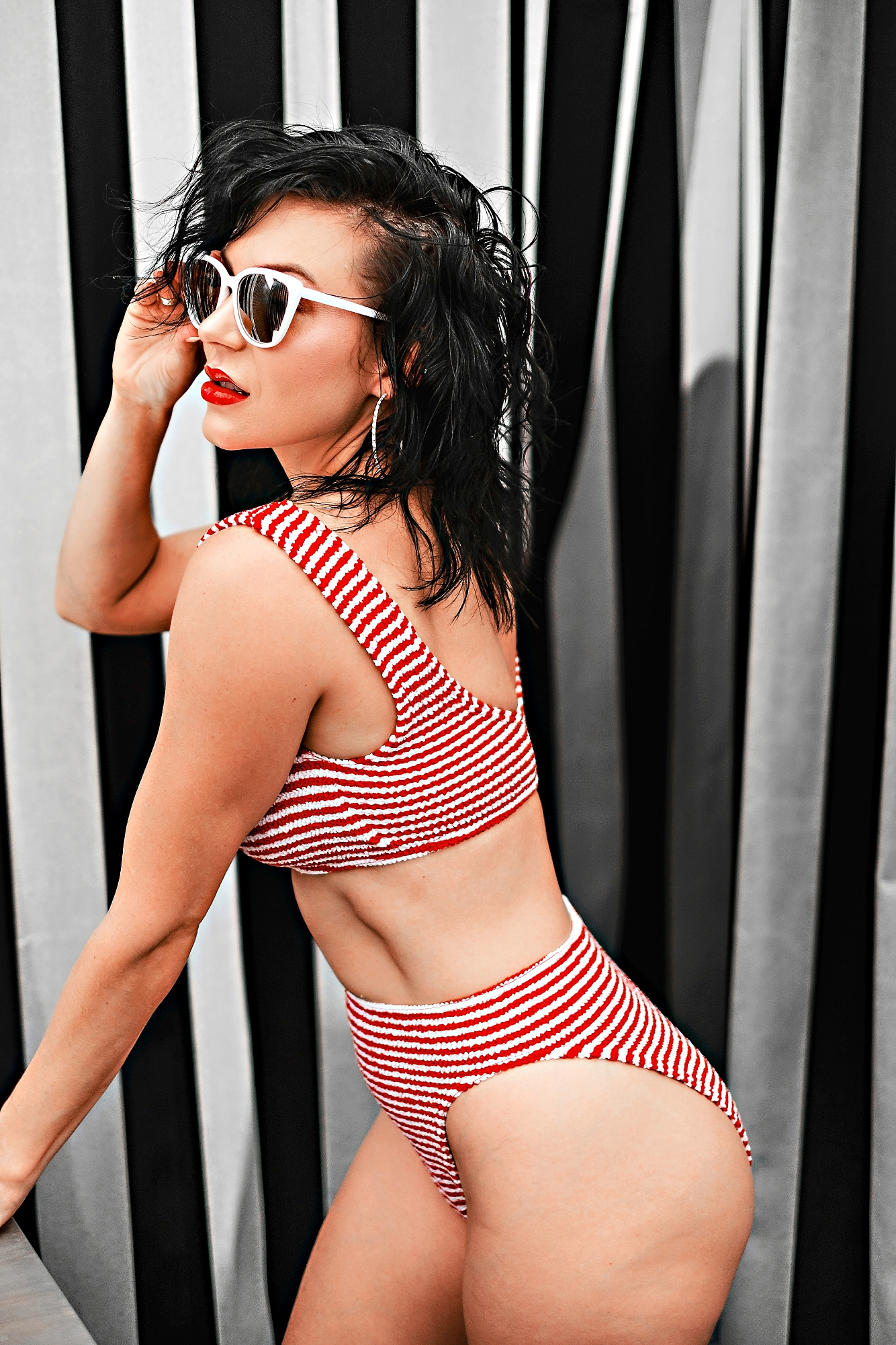 Swimsuit Styles by popular Atlanta fashion blog, Chelissima: image of a woman wearing a red and white strip two piece swimsuit.